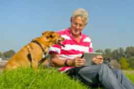 Companion Dog and Senior with Touch Screen Tablet